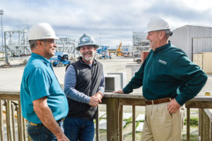 Craig Romero discusses project with Jeff Clement of Dynamic Industries and Iberia Parish Council Member Eugene Olivier